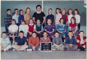 Back row, pink and white striped shirt (I LOVED that shirt!). That's me, thinking I was huge and fat. I'm even slightly hunched, trying to be shorter.