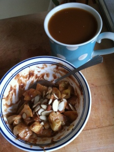 Warm cooked apples, cinnamon, and almond butter with a side of coffee. A delicious Paleo breakfast substitute for oatmeal.